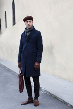 I love this gentleman's pants' hems first of all. My daily closet resembles a lot of this. The color blend and slight contrast of navy and black with leathered brown accents and a patterned scarf are well put together.