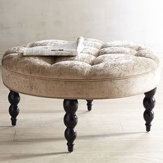 Large enough to be a cocktail ottoman but cozy enough to put your feet up on—our hand-tufted ottoman is easy to love. Also? Easy to work with. Its versatile look is anchored by classic turned-wood legs and a goes-with-anything neutral color.