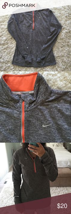 Nike Half Zip Pullover In great condition! Nike half zip pullover in space dye heathered grey with orange detailing. Dri fit material. Womens size small. 89% polyester, 11% spandex. Slight cracking of sleeve logo detailing but other than that, in EUC. Nike Tops Tees - Long Sleeve