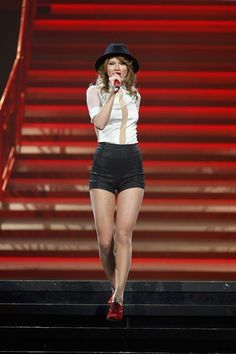 This tuxedo-inspired number she wore on the Red tour. | The Definitive Ranking Of Taylor Swift's Short Shorts
