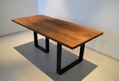 Dining table in solid Oak with steel legs by Young Design