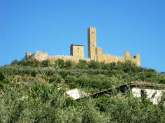 The imposing presence of the castle of Montecchio on top of a hill above Valdichiana