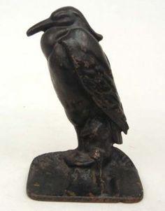 Cast iron crow door stopper
