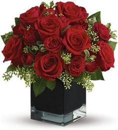 Lush, lavish and spectacularly chic, this gorgeous contemporary bouquet of red roses in a stunning black cube vase makes an exciting gift for almost anyone. Wouldn't you love for someone to send it to you? Arrangement Floral Rose, Rose Flower Arrangements, Christmas Flower Arrangements, Artificial Flower Arrangements, Christmas Flowers, Floral Centerpieces, Design Floral, Seasonal Flowers, Silk Flowers