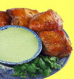 Peruvian Chicken with Green Sauce    Ingredients:  3/4 cup fresh cilantro leaves  1/2 cup soy sauce (low sodium, if you prefer)  3 tablespoons distilled white vinegar  1-1/2 tablespoons vegetable oil  1 tablespoon ground cumin  1-1/2 teaspoons hot paprika  3/4 teaspoon dried oregano  1/4 to 1/2 teaspoon cayenne pepper  6 cloves garlic  8 small bone-in chicken thighs with skin (about 3 pounds)