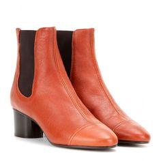 Isabel Marant - Bottines en cuir Danae - Inspirées des Chelsea boots, ces bottines en cuir marron orangé sont signées Isabel Marant. Dotées d'un talon bloc et de quartiers élastiqués, elles offrent un ajustement parfait et une démarche assurée. À porter avec vos jeans slim cet automne. seen @ www.mytheresa.com