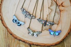 A beautiful necklace with wooden lazer cut illustrations of different moth species. Hangs on a 24 inch chain. You pick from 5 different species.