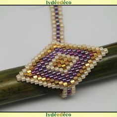 Bague losange perles beige violet plaque or tissage de perles de verre reglable