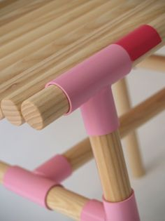 Croquet (Wis design, 2010): a series of stools made of metal tube-knots and wooden sticks. The metal fittings add colorful stripes to the sticks as a recollection of our childhood's croquet.