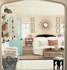 What a cute room... insprational pic from a blog, so I don't know where this room is, but it is GorGEOUS, and so comfy looking.  I noticed I keep pinning photos with white walls, but I would never have white walls in my living areas...