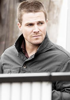 Arrow and The Flash ... Stephen Amell as Oliver Queen