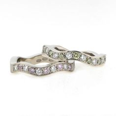 Wave II rings with natural colour diamonds