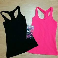 *1 HOUR SALE* Workout tank top bundle Size X-Small Two super cute tank tops that are ready to hit the gym! Both brand new without tags, never been worn, size extra small. Made of a breathable material that won't keep your sweat trapped in while you workout. Back detail has gathered material down the center of the back. Will throw in a free pair of headphones! Smoke free, pet free! SO Tops Tank Tops
