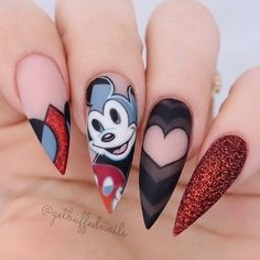 Almond shaped nails with matte Mickey Mouse design, with red sugared nail, and heart design. Have an amazing tour in the UK @getbuffednails with @gemmalambert Ugly Duckling Nails page is dedicated to promoting quality, inspirational nails. Tag us and mention what Ugly Duckling products you used for a chance to be featured:sparkling_h