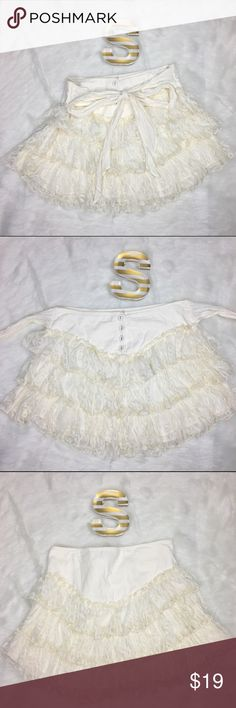 """Betsey Johnson White Lace Ruffle Skirt Size 2 Betray Johnson women's off white lace ruffle skirt with beautiful flowy layers and an adorable tie on the front size 2 Style#: PD34229  Material- Shell: 100% Nylon Lining: 100% Cotton   Measurements- Waist: 30"""" Length: 14.5""""   Customer service is my #1 priority! I strive to not only meet, but to exceed the standard. If for any reason you are unhappy with your order, I will make it right!      Thank you for supporting small business! Betsey…"""