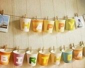 An easy banner made from paper cups.  Take home goodies could be put inside for guests to take home or stack up to use again at the next birthday.