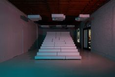 White display stands inside this Los Angeles boutique designed by Bureau Spectacular fit together like a puzzle, forming a set of steps for events and performances.