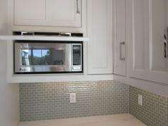 microwave hidden behind drop-down door
