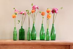 green bottle florals from http://www.myessentia.com/blog/diy-upcycling-projects-101/