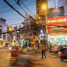 Vietnamese pedestrian among the scooters  Olympus OM-D E-M1, Zuiko 12-40mm 2.8 @ 12mm f/5,6 1/20sec ISO 3200 handheld  #flyingview #lifestyle #citylife #city #handheld #blurred #motion #stillness #street #vietnam #vietnamese #asia #saigon #hochiminhcity #olympus #oem #em1 #zuiko #1240f28pro #travel #night #nightlife #street #longexposure #pedestrian #orange #traffic #scooter #photographer #photooftheday #picoftheday Ho Chi Minh City, Pedestrian, City Life, Scooters, Nightlife, Olympus, Oem, Vietnam, Times Square