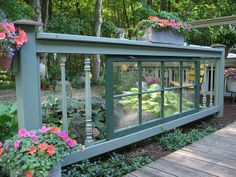 Charming fence made from old windows and stair balusters.