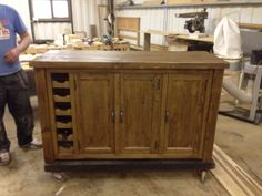 Sideboard made from rough sawn timber with built in wine rack