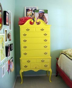 This dresser painted with Cheerful (SW 6903) sure brightens up this room!