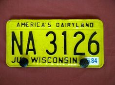 "vintage ""butter yellow"" WI license plate"