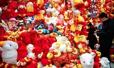 Called to the baa. Beijing shoppers buy new year decorations. Photograph: Lintao Zhang/Getty