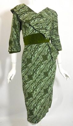 Abstract print green wool 50s dress with wide lapel, hip accent and velvet waist
