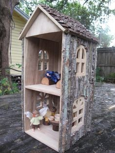 Fantastic little doll's house. Wow!! This is neat! Fairy house in the garden, maybe? Could make a big openable front that locks? (fairies have to be safe too...!) ;)