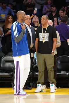 Kobe Bryant talks to Jay Z at a basketball game between the Oklahoma City Thunder and the L.A. Lakers at the Staples Center in Los Angeles.