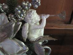 close up of cherub on the sleigh centerpiece I made