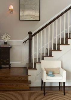 wooden stairs + white wainscoting.