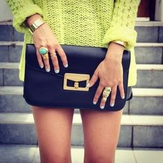 Marc by Marc Jacobs Bianca clutch and the YSL arty ring along with neon sweater... looks amazing.