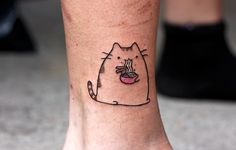 A quick Pusheen I tattooed on my friend Kyla who is both a lover of ramen cooking and kitties. Just finished this and grabbed a picture so it's a tiny puffy, she's quite pleased and I love Pusheen. Pusheen! Halifax, Nova Scotia. Andy Sears