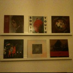 Records displayed as art in our front room via useful little IKEA print shelves.