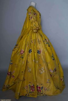 Rococo Period -  Dress - POLYCHROME EMBROIDERED ROBE A LA FRANCAISE, 1765  Goldenrod silk faille, tour de force embroidered exotic florals worked in various stitches & incorporating silk fabric appliques in larger blossoms.