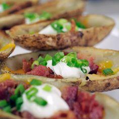 Fully loaded potato skins are oh so indulgent and oh so good. The damage: 1 cup cheddar cheese, 8 slices bacon, 1/2 cup sour cream