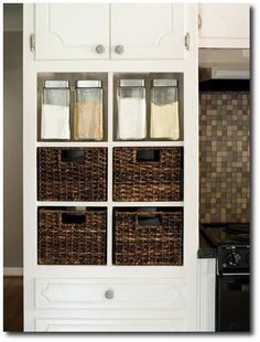 Baskets in cabinet, by the back door, for keys, purse, gloves, etc....