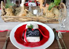 Christmas place setting with nativity centerpiece and handwritten place tag