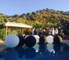 Giant black and white balloons for a birthday make a huge splash among the beautiful people at a pool party in the Spanish hills above Malaga Bubble Balloons, Giant Balloons, Confetti Balloons, Black And White Balloons, Wedding Balloons, Balloon Decorations, Malaga, 50th Birthday, Corporate Events