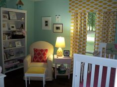 Seafoam and yellow with white furniture and dark floors
