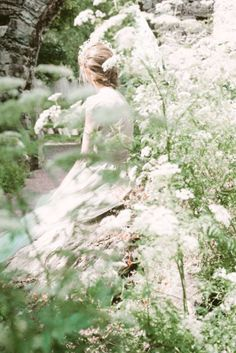 ((Closed rp)) Andrina smiled as she sat in the garden of a local park smiling as she watched the butterflies. Her crystal blue eyes watched as  the butterfly landed from flower to flower
