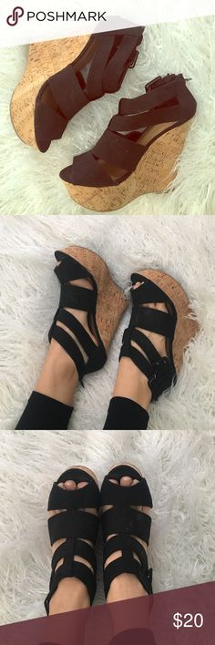 Black & Cork wedges! The adorable summer staple! These blank canvas cork wedges are versatile and comfy! 5 inch heel. Some light fraying on the buckles. Other than that they're in great shape! Delicious Shoes Wedges
