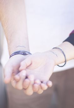 Aquarius lover tattoos! This would be awesome for me and my husband to get since we are both Aquarius! Each could get one water symbol on wrist
