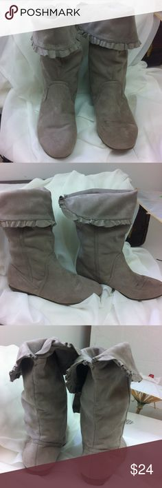 Light grey Aldo boots Super soft Aldo boots in light grey. These can be worn high or folded over more for a lower style boot. They are a flat rubber wedge heel. 3/4 inch in back. They have a couple minor marks on them - hard to see but worth noting. Aldo Shoes