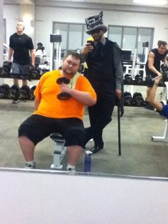Man helps his friend who is trying to lose weight but is conscious about going to the gym.