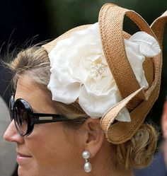Queen Maxima ( Dutch royalty) 1 July 2013 Oosterpark Amsterdam. Such a unique hat... and the sunglasses is by Giorgio Armani.