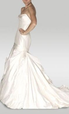 Justina McCaffrey 1008 Anna 10: buy this dress for a fraction of the salon price on PreOwnedWeddingDresses.com